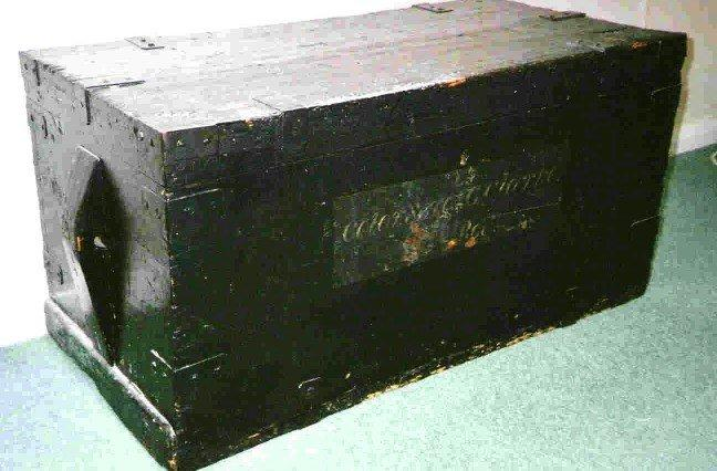 A Trunk and Letters in a Canvas Cutlery Holder